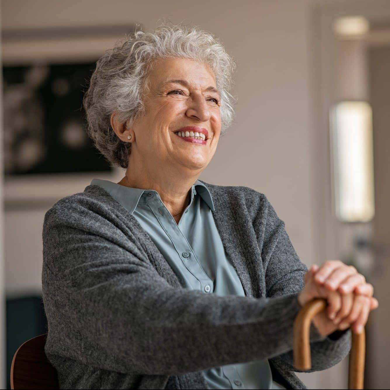 Happy smiling senior woman relaxing at home